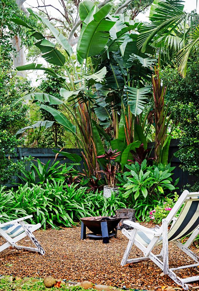 "Drawing inspiration from the tropical plantings in Bali, [this Sydney garden](https://www.homestolove.com.au/bali-style-garden-1877|target=""_blank"") features lush greenery from corner to corner. In this clearing a firepit and relaxed chairs sit, ready for an evening of entertaining."