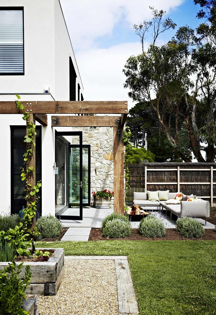 "Inspired by gardens that usually accompany Italian villas, this [dual-purpose holiday home](https://www.homestolove.com.au/a-dual-purpose-holiday-home-2579|target=""_blank"") features a sophisticated outdoor entertaining zone complete with generous lawns, a fire pit, and an outdoor sofa to boot."