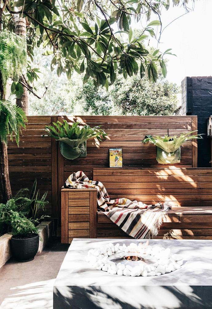 "The [heritage-listed terrace in Sydney](https://www.homestolove.com.au/redesign-of-a-heritage-sandstone-sydney-terrace-6317|target=""_blank"") was given a brand new outdoor entertaining zone complete with ample built-in seating and lush plantings. A statement EcoSmart fire pit is the crowning feature."