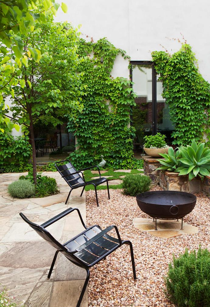 "When it comes to creating the [perfect outdoor entertaining zone](https://www.homestolove.com.au/belle-australian-landscape-designers-book-19878|target=""_blank"") a fire pit is an easy way to make sure the area is trans-seasonal. Choose a fire pit with a sculptural shape to make a bold statement."