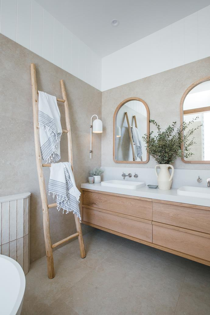 """The 'Angourie' American oak vanity by Loughlin Furniture x KK Homewares, has been custom made to fit the space. 'Alura Arch', American oak mirrors, [Loughlin Furniture x KK Homewares](https://www.kyalandkara.com/shop/alura-arch-mirrors/