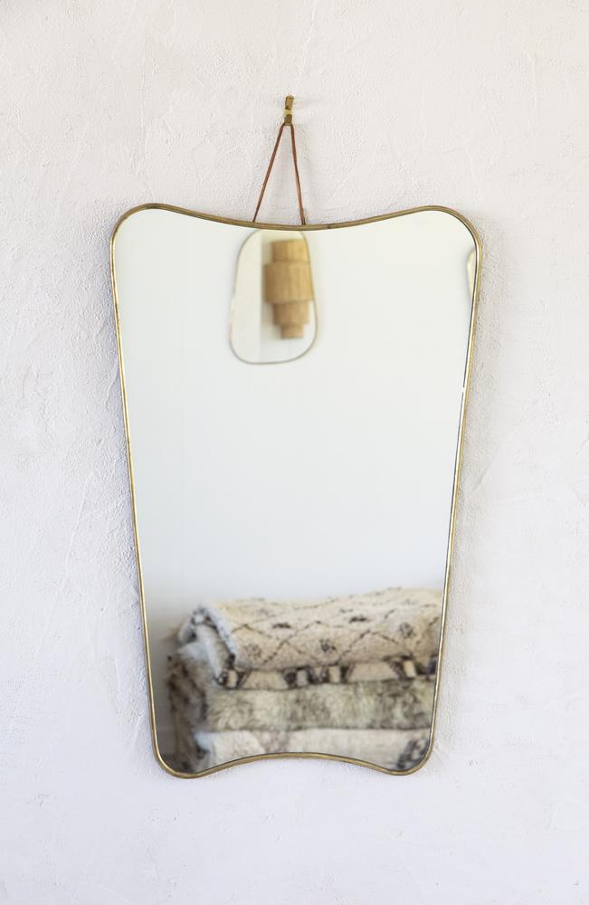 "Brass Trapeze Mirror - L, price on enquiry, [Tigmi Trading](https://tigmitrading.com/collections/accessories-all/products/brass-trapeze-mirror-l|target=""_blank""