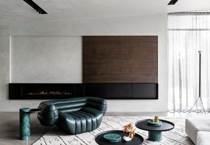 In the triangular shaped living area, Baxter 'Tactile' armchair from Criteria. 'Gazelle' rug from Armadillo & Co. A Flos 'Luminator' floor lamp from Euroluce stands by the full-height windows.