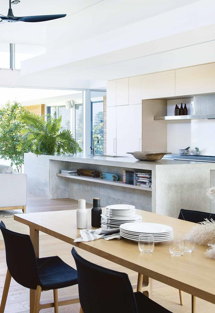 "Becoming the central feature of the open-plan kitchen/living/dining space in this [eco-friendly Perth home](https://www.homestolove.com.au/contemporary-eco-friendly-home-perth-17078|target=""_blank""), a statement concrete kitchen island contrasts beautifully with the blonde timber flooring and cabinetry in the space."