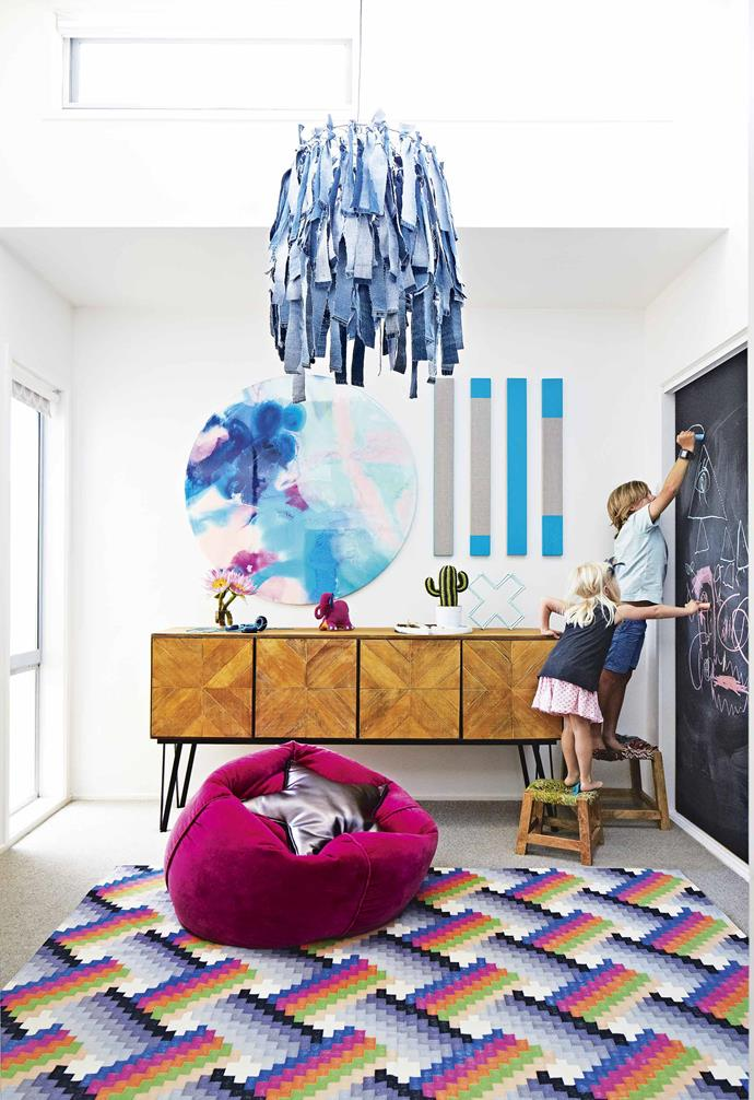 "Due to the planning delays, Megan, Dan and the kids were forced to move into their new home before it was finished, however, it didn't take long for them to stamp their personality on the home with an eclectic yet cool-and-considered interior fit-out.<br><br>**Playroom/guest bedroom** A denim chandelier from [Moss Grotto](https://mossgrottostore.com/|target=""_blank""