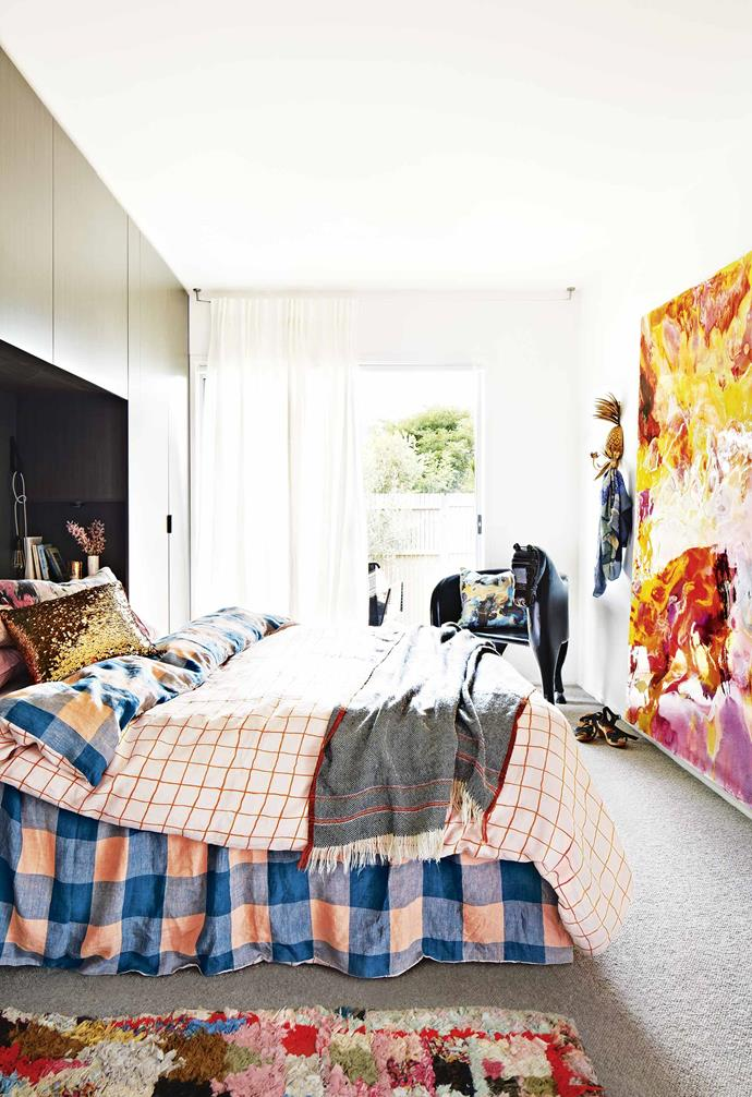 """It makes me smile every time I arrive home!"" Not surprisingly, a carefully selected edit of art has finished the home with bursts of colour. Megan's own highly sought-after resin masterpieces add a contemporary twist to the home's coastal charisma.<br><br>**Master bedroom** The bold tones in Megan's artwork are echoed on the bed, dressed in [Kip & Co](https://kipandco.com.au/