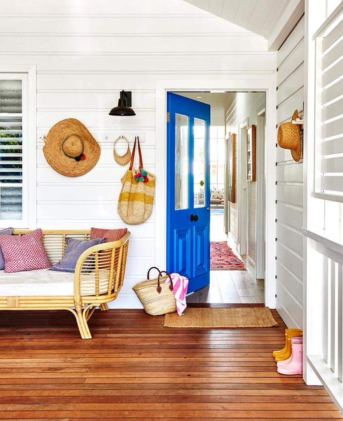 "Visitors to this family's [colourful coastal cottage in Byron Bay](https://www.homestolove.com.au/coastal-cottage-byron-bay-20442|target=""_blank"") enter through a colourful front door painted in Dulux ""Mykonos""."
