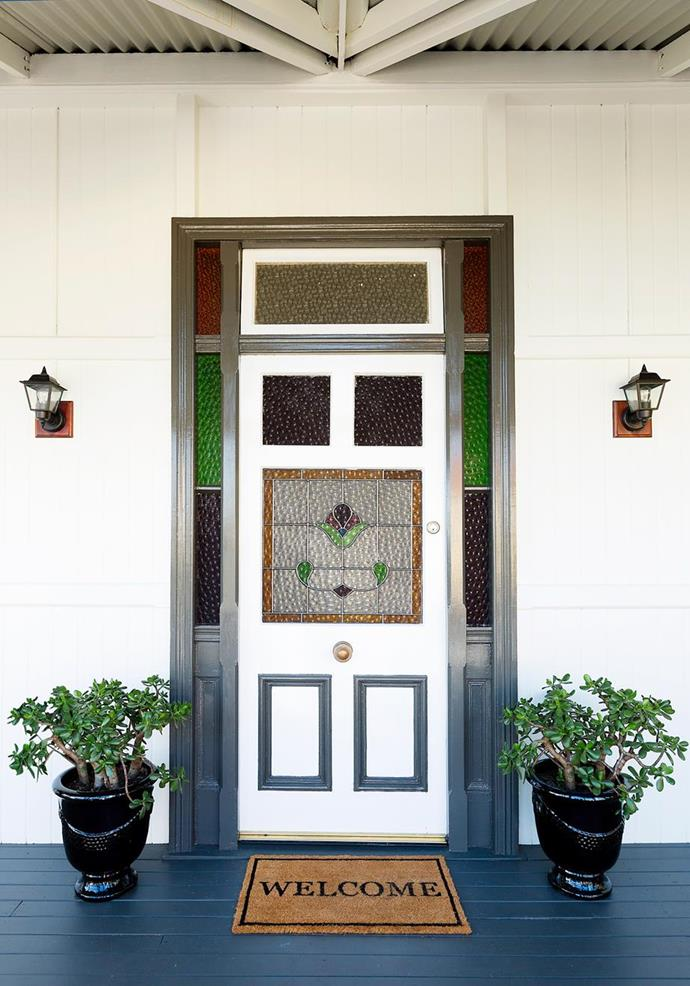"A beautifully [lived-in Queenslander](https://www.homestolove.com.au/a-live-in-renovation-of-a-federation-queenslander-4894|target=""_blank"") has created calming symmetry with identical plants and pots side by side with a stained-glass door."