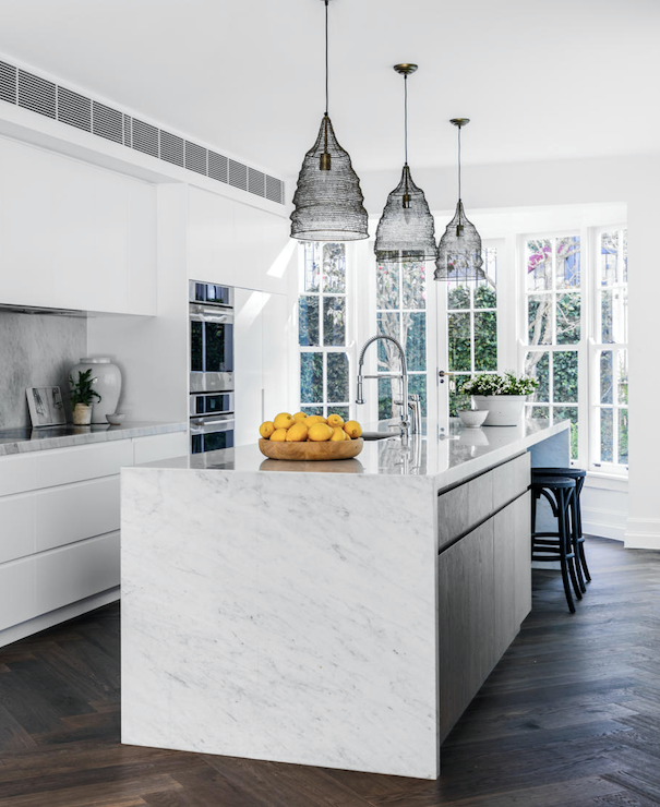 Benchtop in Carrara marble from Granite & Marble Works. Pendant lights, Ruby Star Traders. White vase, Orient House. Timber bowl, Ondene.