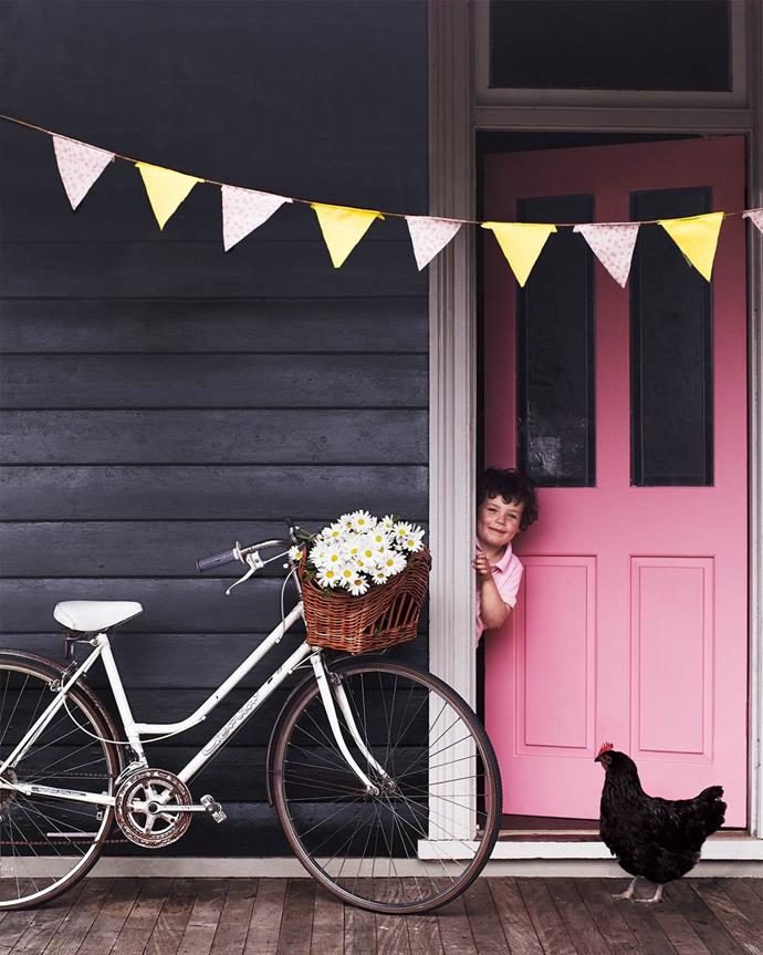 "Rain or shine, this [Blue Mountains cottage](https://www.homestolove.com.au/retro-style-furniture-12135|target=""_blank"") radiates warmth thanks to bold colours and playful vintage finds. The exterior is painted in Taubmans Black Fox."