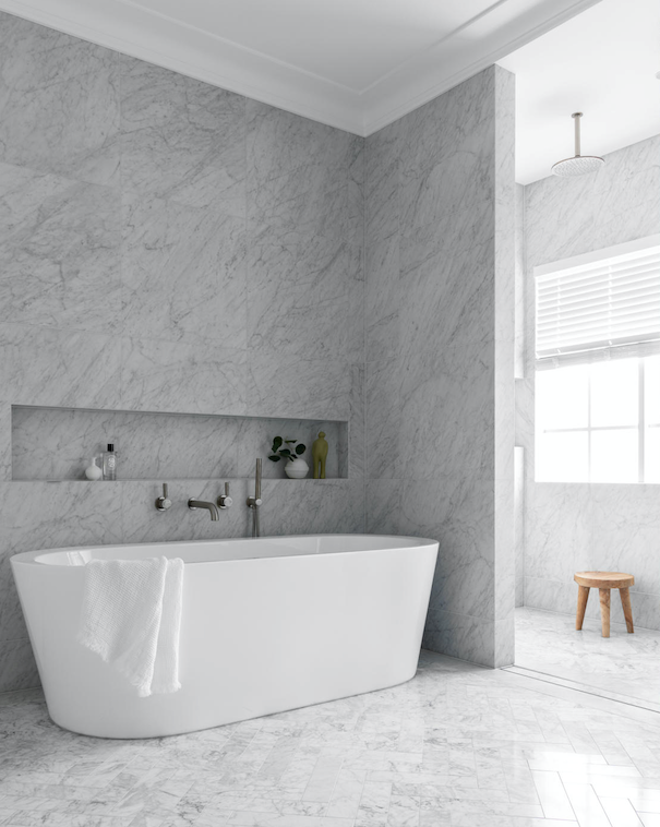 Carrara marble wall tiles, flooring, all Granite & Marble Works. Bath, Candana. Brodware' City Stik' tapware in Brushed Platinum. Custom joinery by Jemma Brender and Trademark Joinery. Vase, Space. Towel, Saardé. Stool, Inartisan.