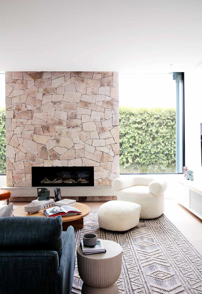 "**Living room** The beautiful feature fireplace, which can also be seen from the back garden, is clad in Bronte Rock from [Surface Gallery](https://surfacegallery.com.au/|target=""_blank""