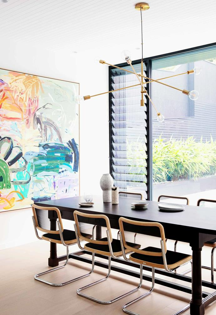 "**Dining room** This space overlooking the pool is decorated with a large artwork by Casey Burrill, who sells through galleries such as [Fenton & Fenton](https://www.fentonandfenton.com.au/|target=""_blank""