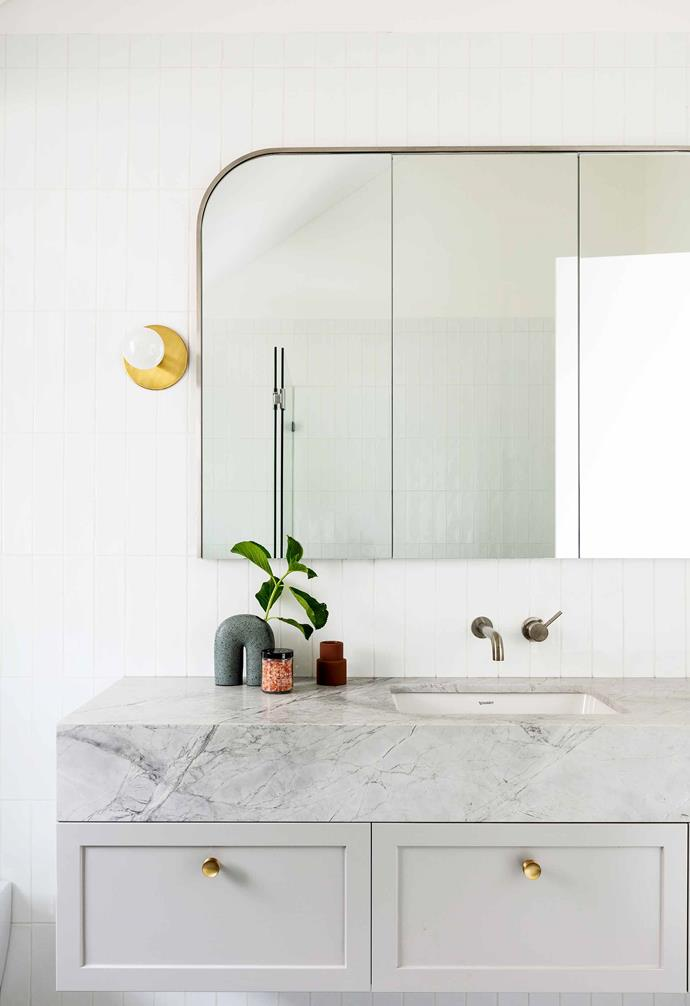"**Children's bathroom** Super White Dolomite works well in here. The polyurethane cabinetry has a [Dulux](https://www.dulux.com.au/|target=""_blank""