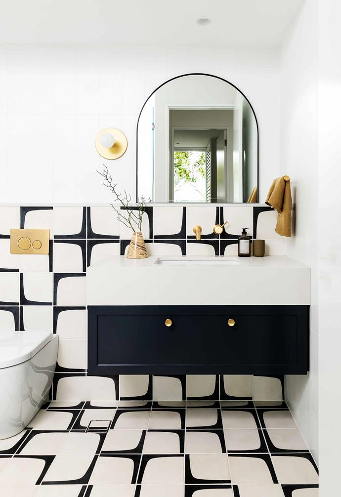"""**Powder room** The bold encaustic-concrete [Popham Design](https://www.pophamdesign.com/