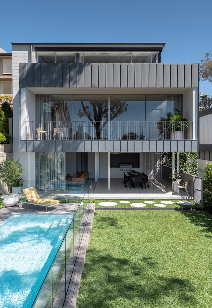 The simple garden design allows the architecture to shine.