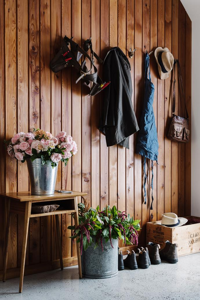 Buckets of David Austin roses and flowering stems of amaranth in the mud room.