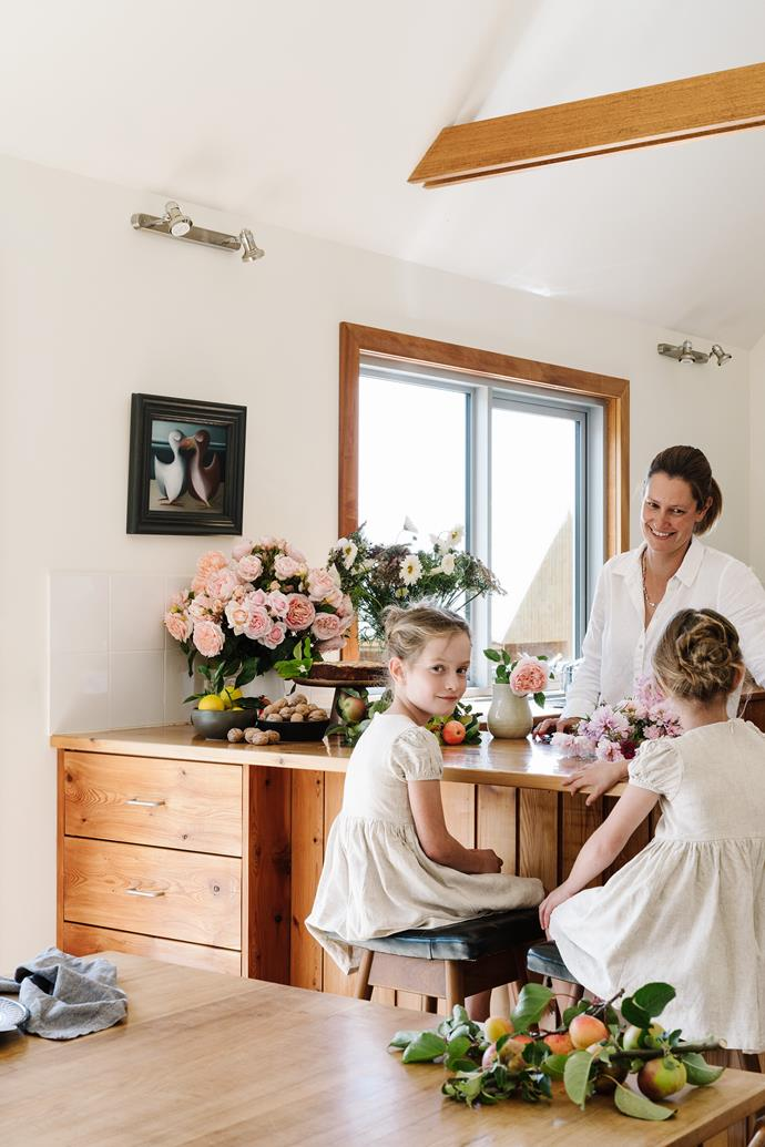 The girls enjoy helping their mum. The kitchen cabinetry is celery top pine and made by local builder Greg Edwards and the kitchen stools are vintage T H Brown in blackwood.