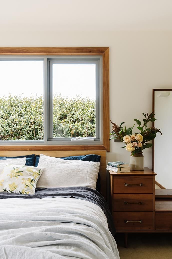 The bed is made of Tasmanian oak, the side table is a Myer vintage Heritage piece and the vase is a vintage store find.