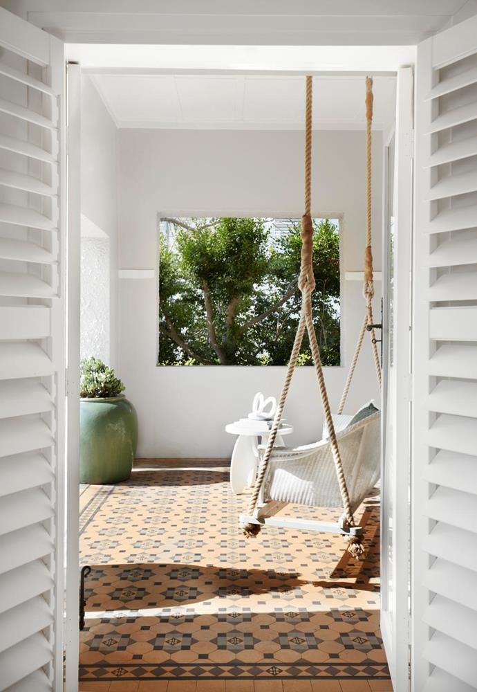 The builder, Andy Bishop of Arthouse Projects, repurposed an old cane lounger into a romantic swing seat. Original tiles.