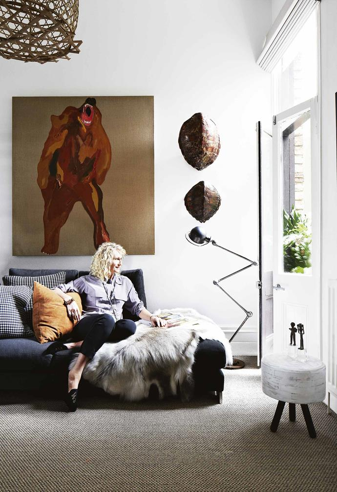 **Living area** Owner Angela takes in the view. Artwork: *Bear Market* by Darren Mcdonald.