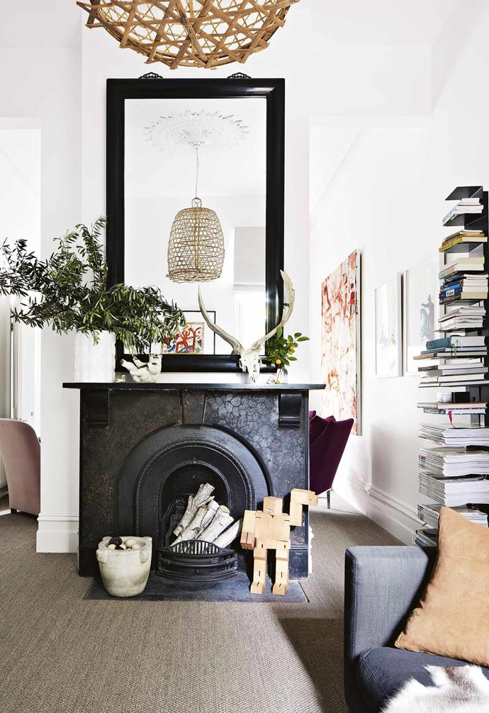 **Living area** A fireplace forms the centrepiece of the living room.