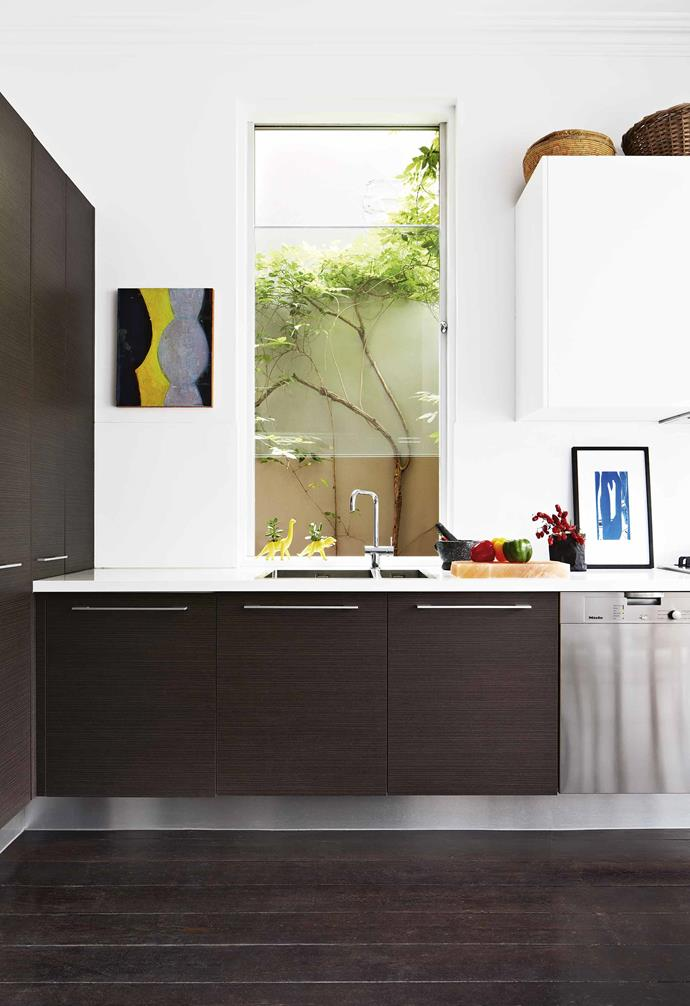 **Kitchen** Only cosmetic changes were made to update the galley-style kitchen. Artwork: Katherine Hattam.