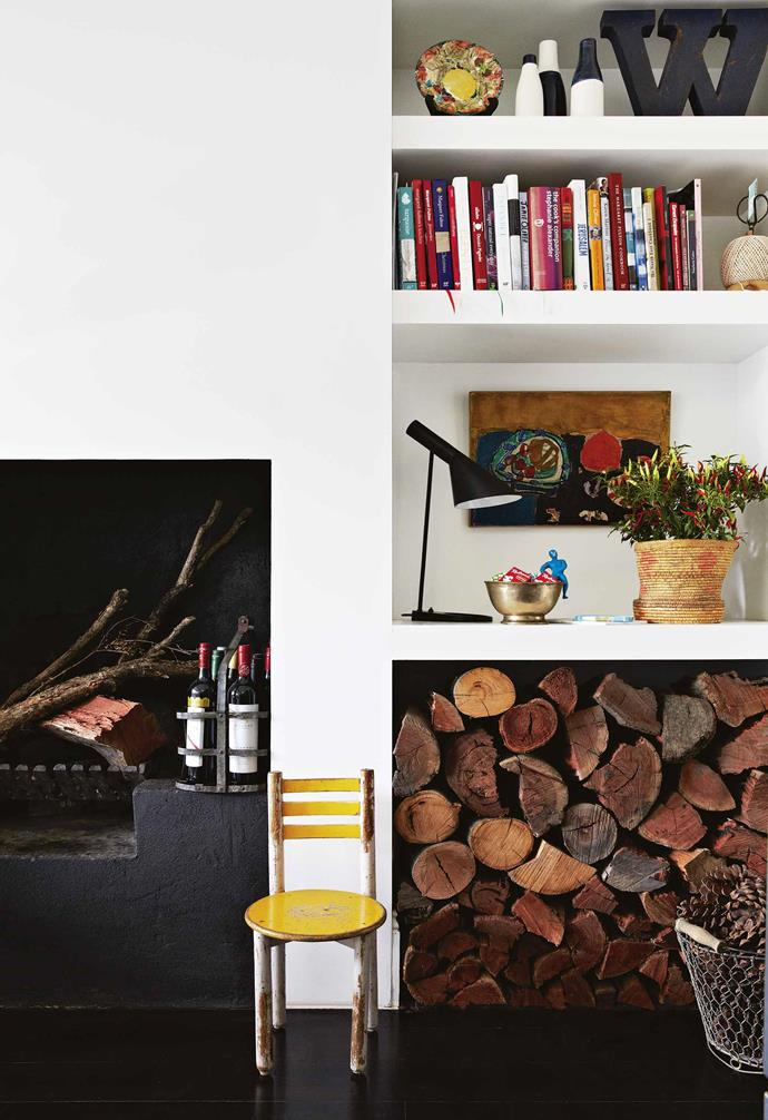 **Kitchen** The fireplace was in perfect condition and John uses it to cook as much as he can, hence the healthy log pile. Artwork: Paul Augustin Aizpiri.