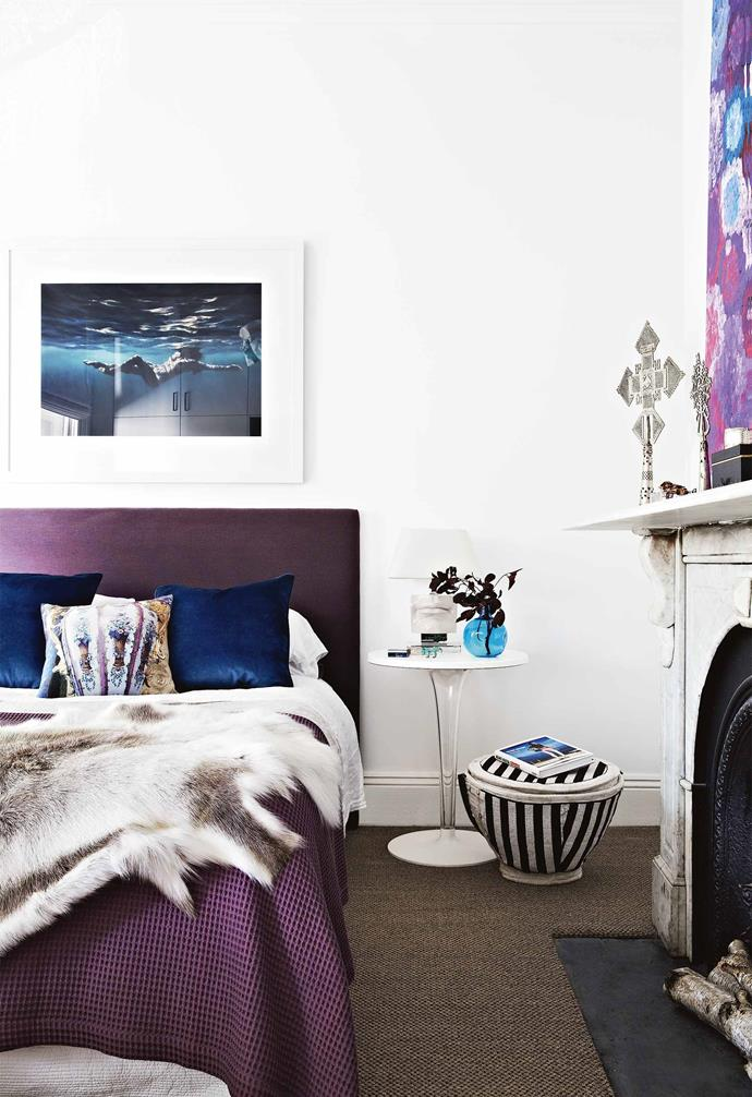**Bedroom** In the master bedroom, the jewel tones of the bedhead and cushions are sophisticated takes on their bright counterparts seen in the artworks. Artwork: Martine Emdur.