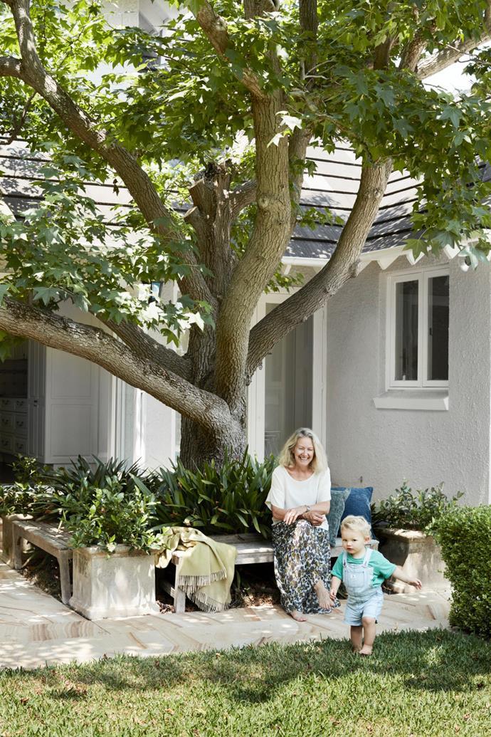 Owner Kim and her grandson Freddie enjoy the garden.