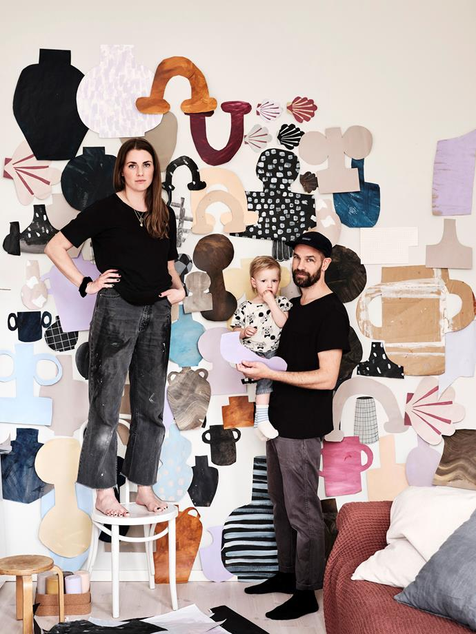 Emilia with her husband Fredrik and their son Igor in front of the creative's statement art wall. Emilia's style is all about building layers of detail using character-filled design features.