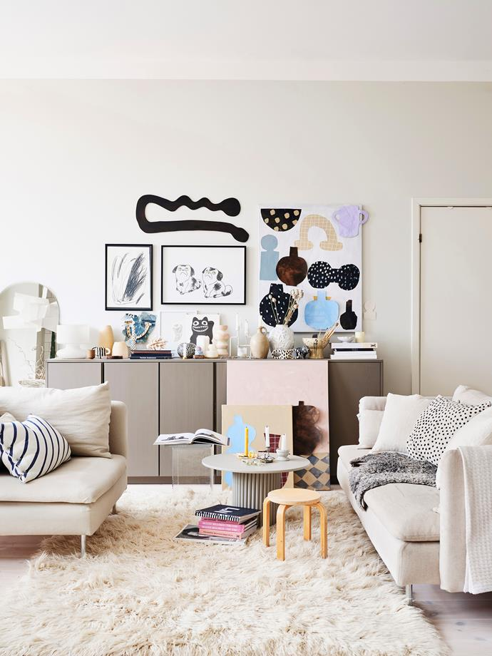 """The living space is Emilia's favourite room in the house. The row of [Ivar cupboards from Ikea](https://www.ikea.com/au/en/p/ivar-cabinet-pine-10215000/ target=""""_blank"""" rel=""""nofollow"""") have been clad with custom side panels, a new top and a fresh lick of paint. The vases are a mix of Emilia's own, Carina Seth Andersson for Marimekko, Anna-Lisa Thomson and flea-market finds."""