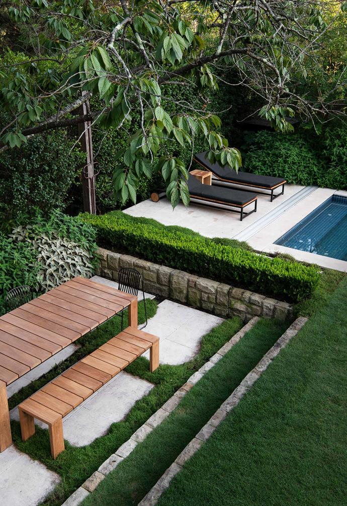 In a nod to the 1960s conversation pit, this sunken space under an existing cherry tree lends just the right amount of interest to its poolside location in Sydney.