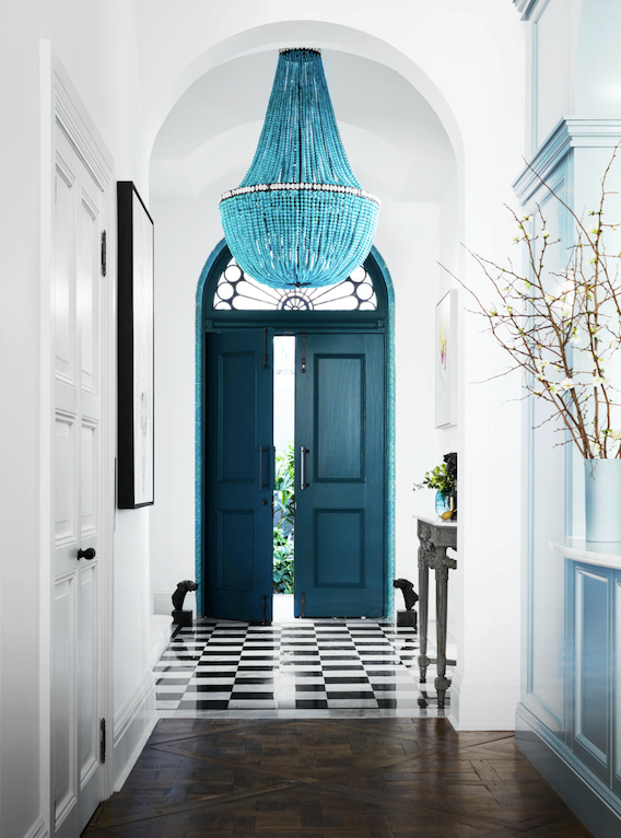 """""""When you open the front doors you realise how unique the property is. It's a special moment,"""" Dominique says of her home's theatrical tiled entrance, which ends where the French parquetry floor begins. One of the property's priceless features, the historic floor was protected by Sandlik Constructions, hired by Dominique for the duration of the renovation."""