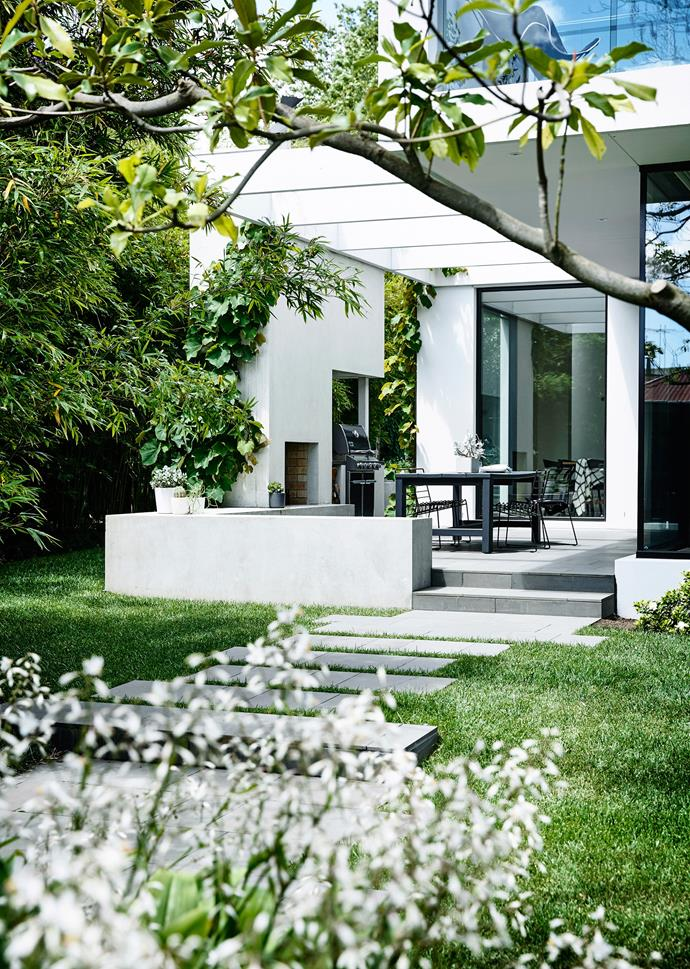 """This [Melbourne garden](https://www.homestolove.com.au/a-garden-of-contrasts-that-works-harmoniously-3105 target=""""_blank"""") is so abundant and established it looks as though it's been the life-long companion to the Victorian-era weatherboard home it surrounds. In fact, it's a recent development, installed in tandem with the home's renovation two years ago."""