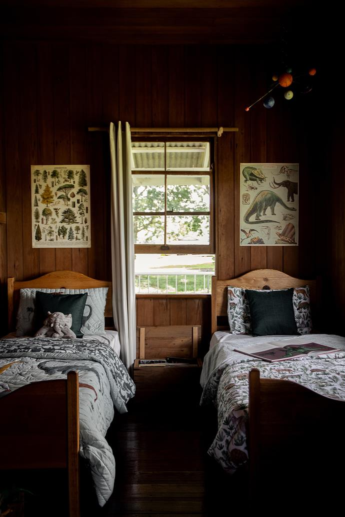 The children share a bedroom, with Koda's bed (left) presided over by a tree poster from The Small Folk. To the right is Asher's bed with bed linen from Adairs.