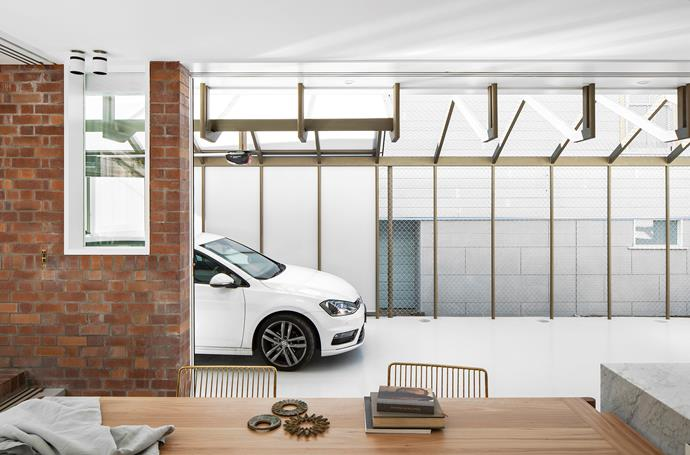 The open-plan carport increases the interior space when not in use and can be sealed off with sliding doors. The homeowners often use the breezy space to host large gatherings.