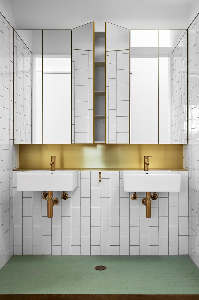 Astra Walker Eco Brass tapware echoes the home's sunny golden hues and is offset by Pistachio Winckelmans floor tiles. Brassed off White Parisi Quadro wall basins and Ceramica Vogue tiles from Classic Ceramics play a supporting role to the brass finishes.