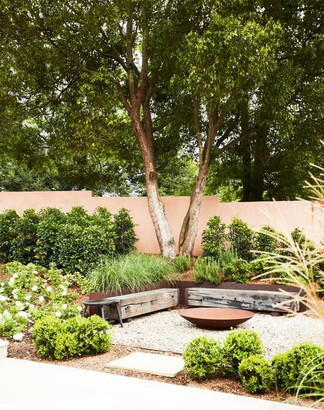"Peter Fudge reorganised the outdoor areas of this [heritage home](https://www.homestolove.com.au/family-friendly-heritage-home-with-mediterranean-influence-21388 |target=""_blank"") into a series of relaxation zones. In the front garden, there's a beautifully landscaped pool area, a cosy conversation spot with firepit, and wide sandstone paths lined with layered greenery."