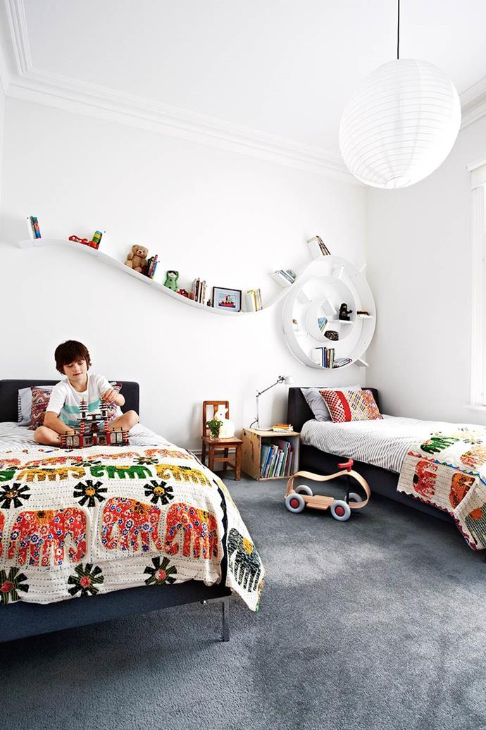 """Colourful accessories in the boys' room create a vibrant environment for growing minds, and this [dramatic timber home](https://www.homestolove.com.au/gallery-paula-and-martins-dramatic-timber-home-renovation-2015-1413