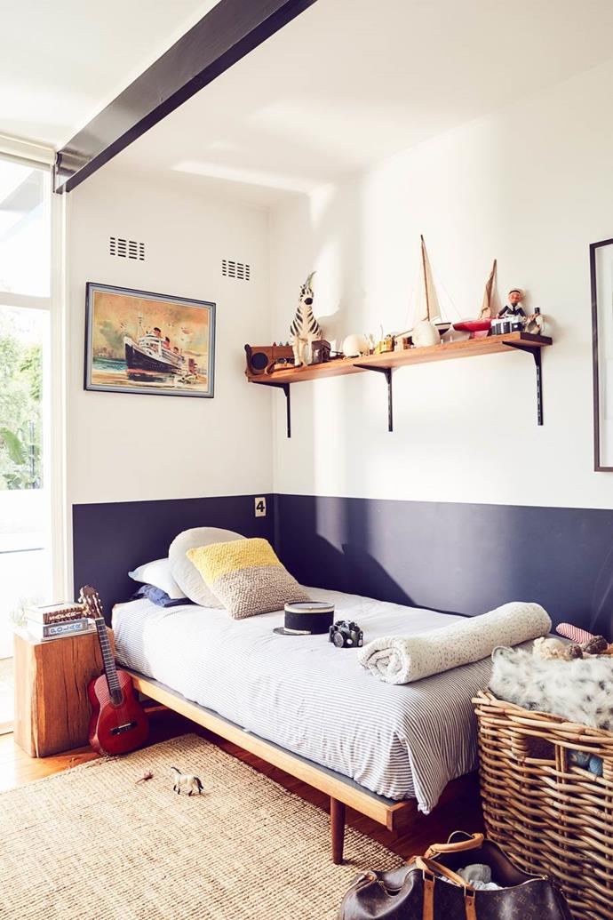 """Clean and simple, the nautical style of this kids' bedroom will never go out of style, and it also doubles as a playroom in a [mid-century style home](https://www.homestolove.com.au/comedian-tim-ross-original-1950s-home-3980