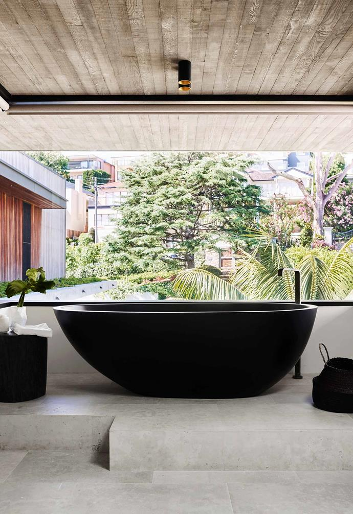 Designed by Brisbane architect Shaun Lockyer, a Moda 'Lucia' stone bath from ACS Designer Bathrooms is the drawcard of this open bathing space.