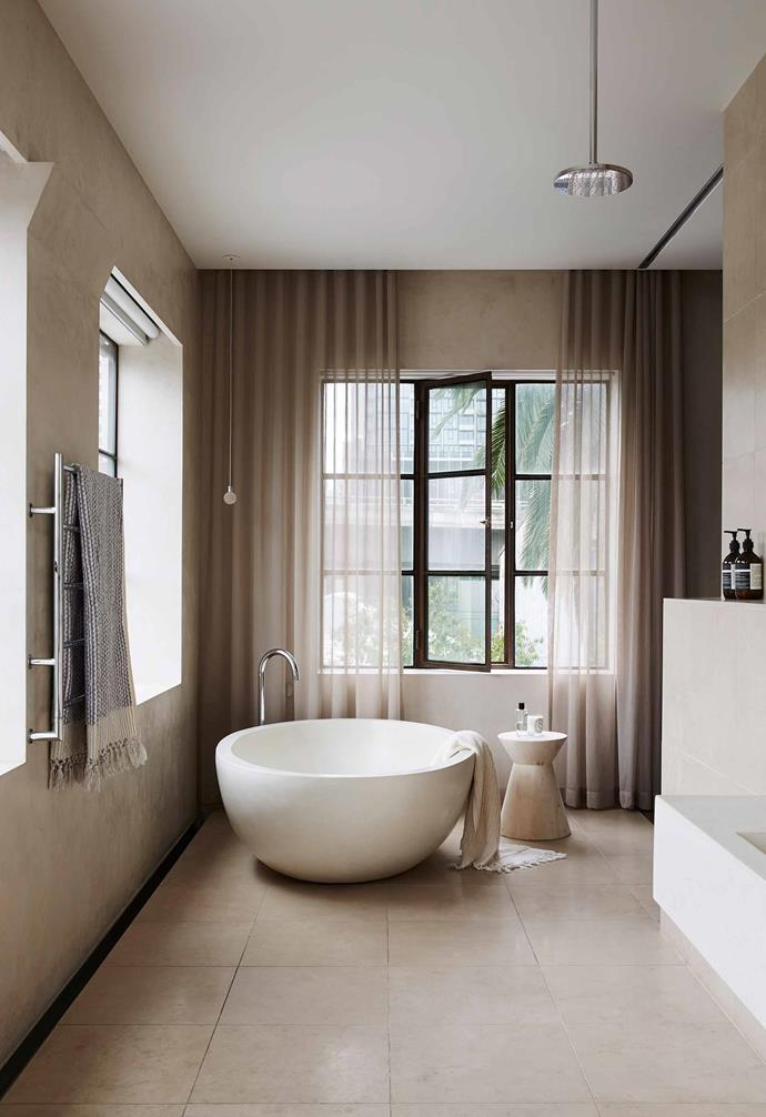 A Rodney concrete bath from Boyd Alternatives is the defining feature of this Melbourne ensuite by Tammie Zarro Design and March Studio.
