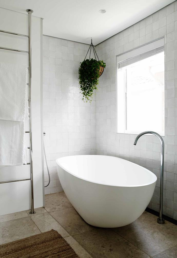 The white Moda 'Lucia' stone bath from ACS Designer Bathrooms is perfect for this ensuite by JPR Architects.