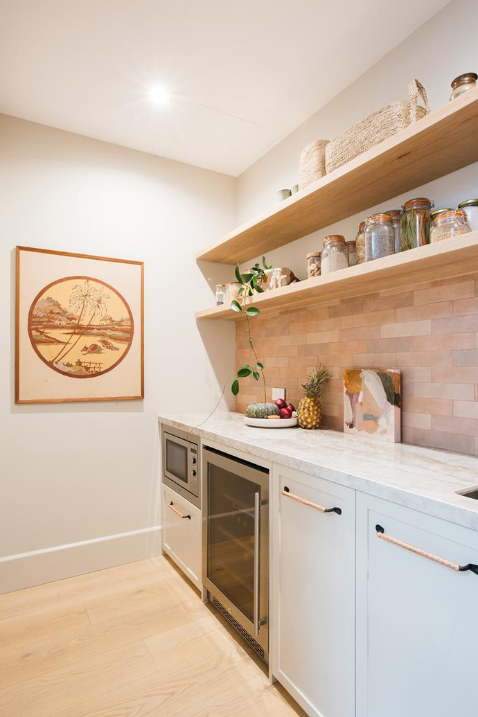 Decor8 Terracotta Matte tiles (62x250mm), from Beaumont Tiles and an artwork by Brittany Ferns add colour and personality to the butler's pantry.