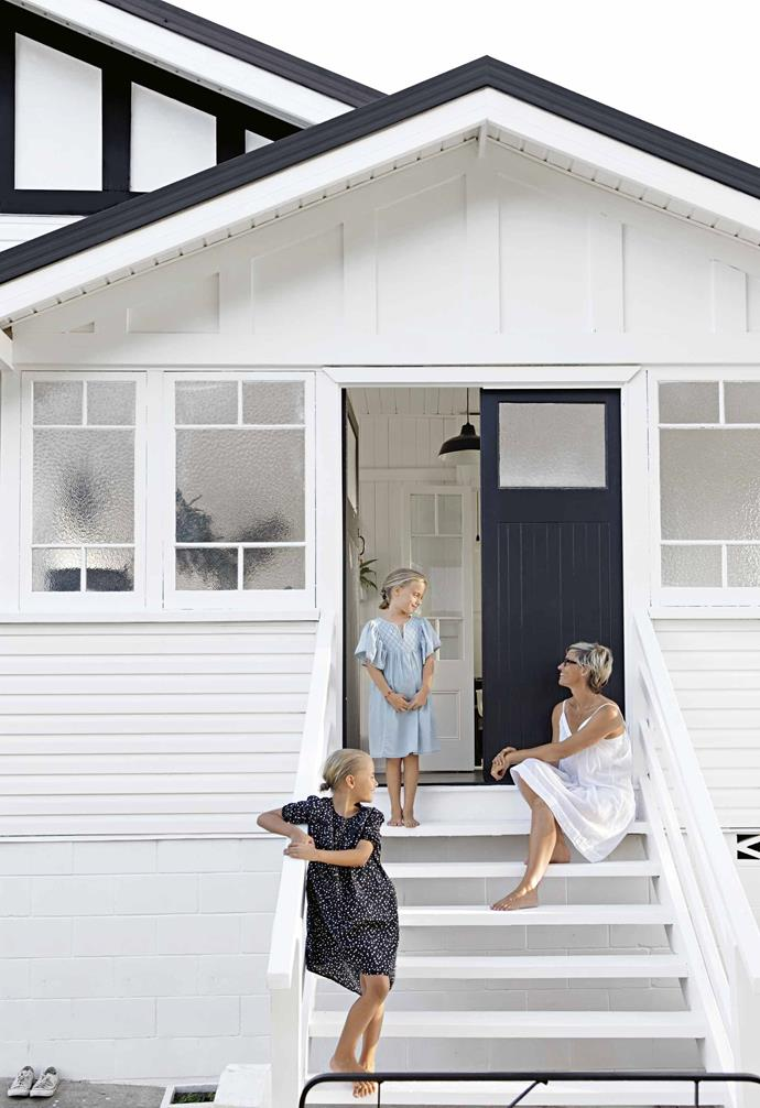"Home for Simone, her husband Shannon, and twin daughters Indigo and Lakota, is a [timber bungalow](https://www.homestolove.com.au/californian-bungalow-renovations-21187|target=""_blank"") in Queensland's Noosa Hinterland. Like the many story-stamped treasures she brings through the doors, the house itself holds heart and history.<br><Br>**Facade** Homeowner Simone Barter, with daughters Indigo and Lakota, [whitewashed her Queensland home for a classic look](https://www.homestolove.com.au/white-house-exteriors-21372