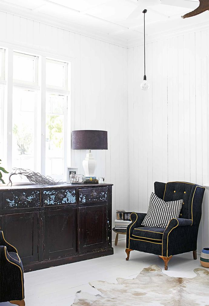 "With the layout right, Simone set about creating a bright, all-white backdrop for her stylist's trove of wares, both made and collected. ""My husband kept saying 'I don't want to feel like I'm living in an igloo'. He had to trust me. Even a week before we moved in, he was still saying he wasn't sure. But because there's so much texture in the walls, he was very happy in the end.""<Br><br>**Living area** Reupholstering an armchair made it a favourite. ""I love old with new,"" says Simone."