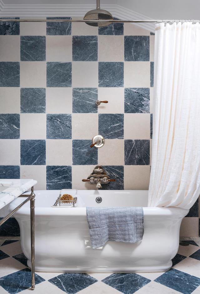 *Wall finish/flooring* Italian tumbled marble tiles in custom chequerboard pattern. *Accessories* Custom-made Italian linen shower curtain.