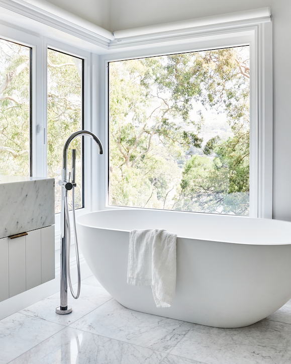 *Flooring* Honed 'Carrara' marble slabs.  *Bath* 'Chloe' bath from ACS Designer Bathrooms. *Bath tapware* Sussex 'Scala' floor spout from Reece.