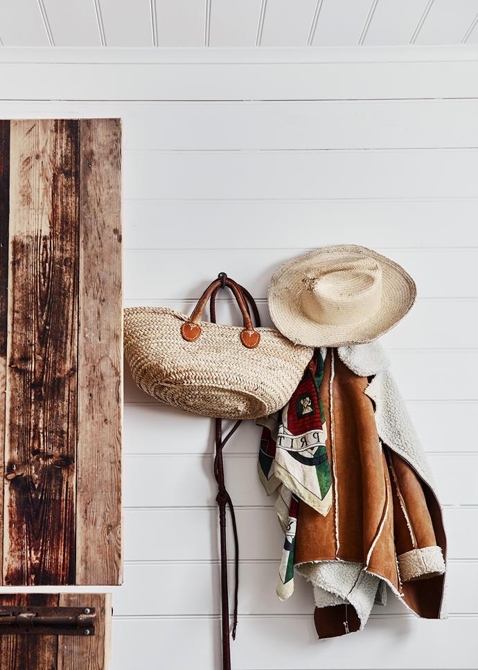 Hooks on the wall provide handy storage.
